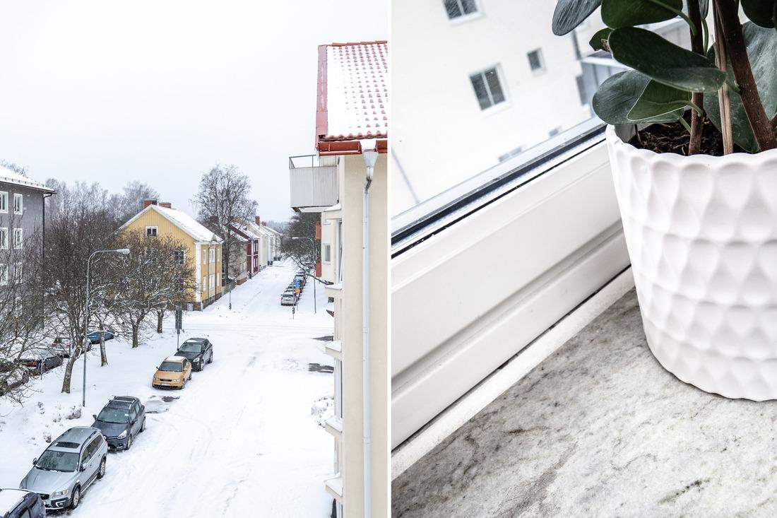 Härlig vy mot huset på Sofiagatan och stenfönsterbrädor...